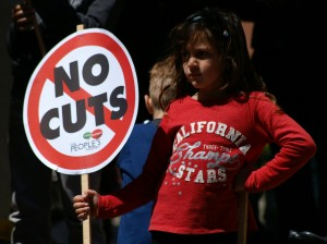 "Young emboldened activist stands defiantly for ""No Cuts"""