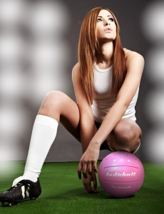 Sexy or sexist female footballer with lady ball