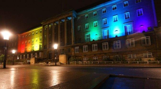 Rainbow illuminated Norwich City Hall during vigil against hate for Orlando Pulse Gay Bar shooting