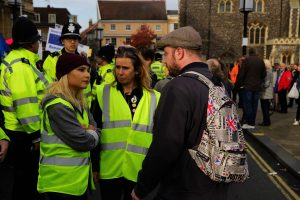 Cllr Jess Barnard and Abby Hoffmann debating the issues with Joe from the Unity UK demo